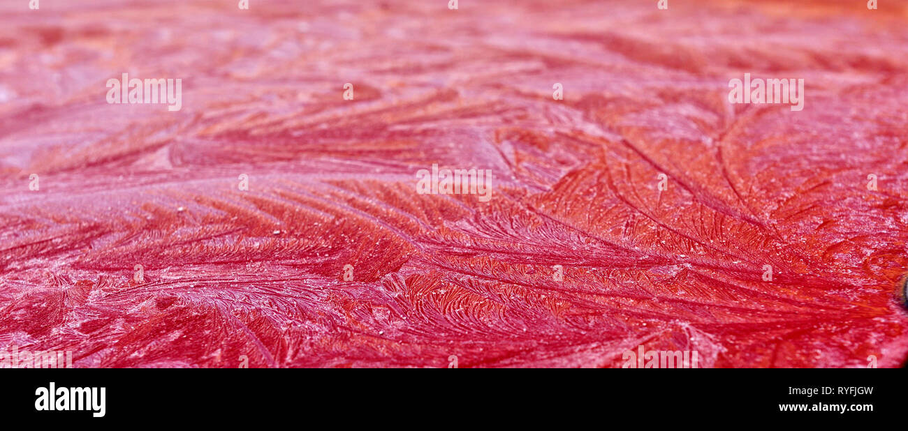 Abstract pattern of frost on red - Stock Image