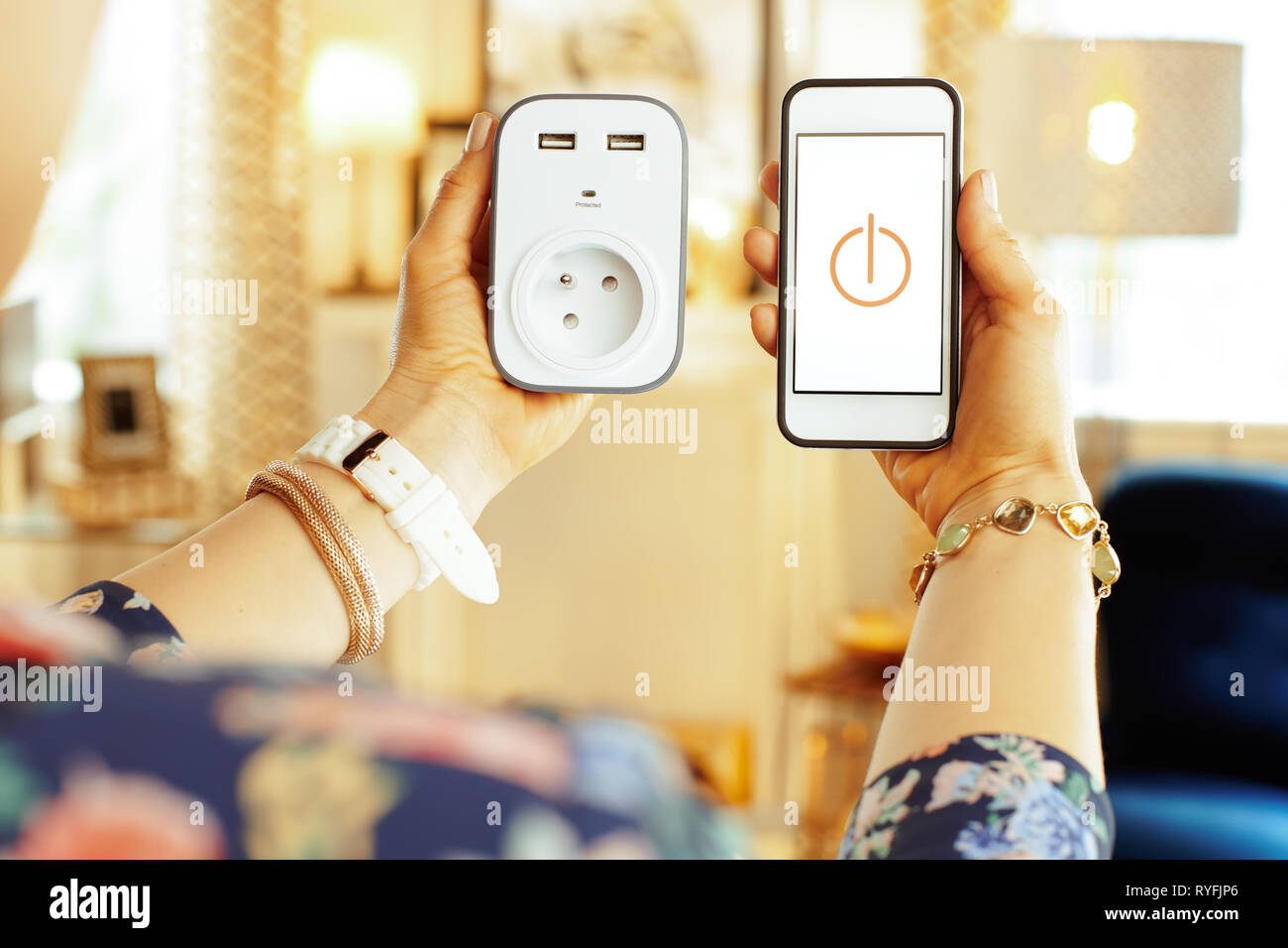 Closeup on smartphone with smart home app and wifi smart plug in