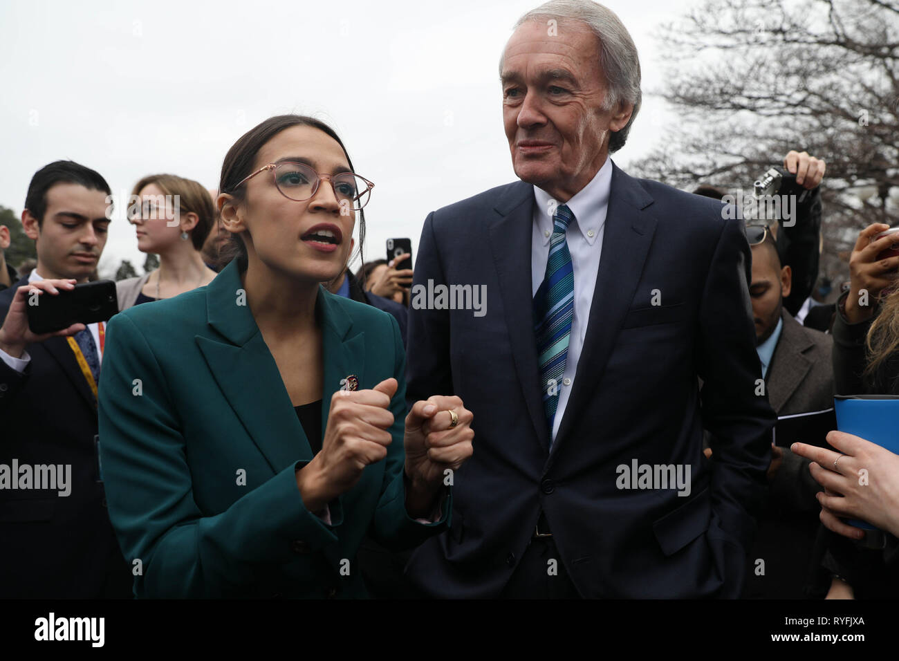 U.S. Rep. Alexandria Ocasio-Cortez, and Senator Ed Markey answers questions during the announcement for the Green New Deal legislation during a press conference outside the Capitol Building February 7, 2019 in Washington, D.C. Stock Photo