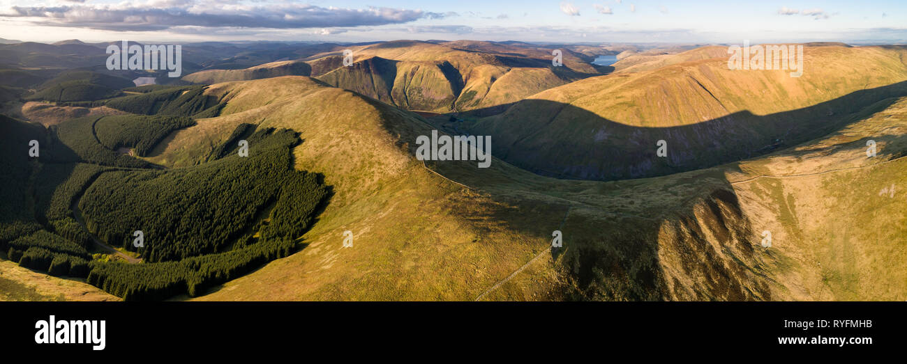 Aerial panorama showing the hills around Talla Reservoir in the Scottish Borders looking North in evening light towards the distant Pentland Hills. - Stock Image