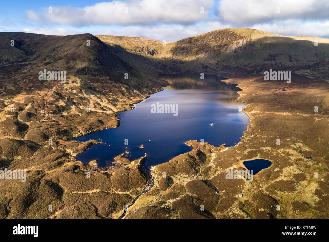 Aerial image looking north across Loch Skeen towards Molls Dod Cleuch. - Stock Image