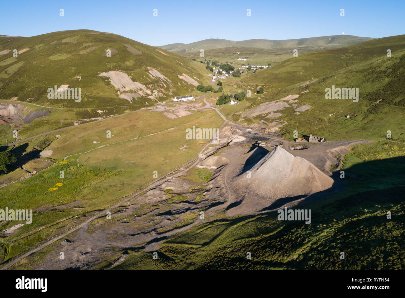 Arial Image of Wanlockhead, Scotland's highest village showing old mine workings and industrial waste. - Stock Image