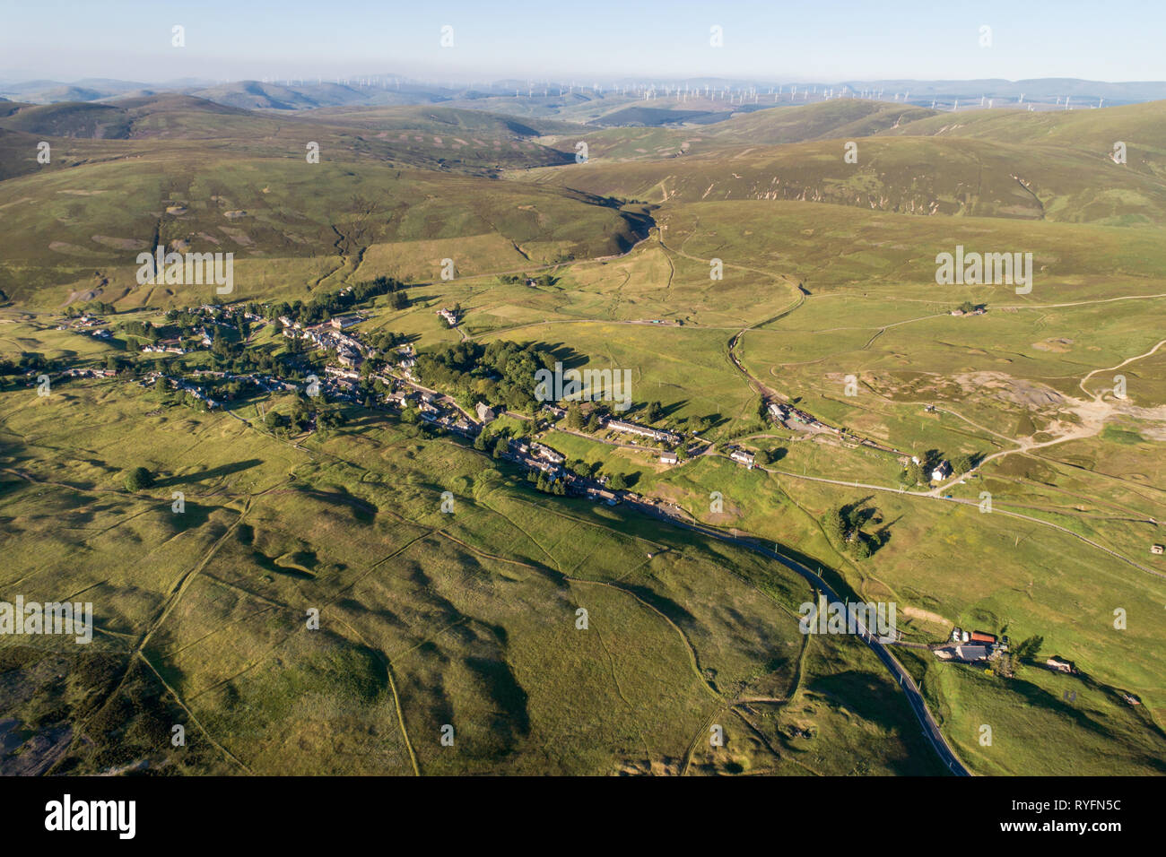 Aerial image of the village of Leadhills, arguably Scotland's highest village, showing historic mining sites and old shafts. - Stock Image
