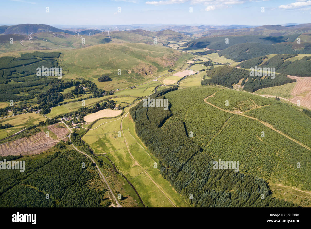 Aerial image showing the Upper Tweed Valley and the village of Tweedsmuir looking north towards the distant Pentland Hills. Stock Photo