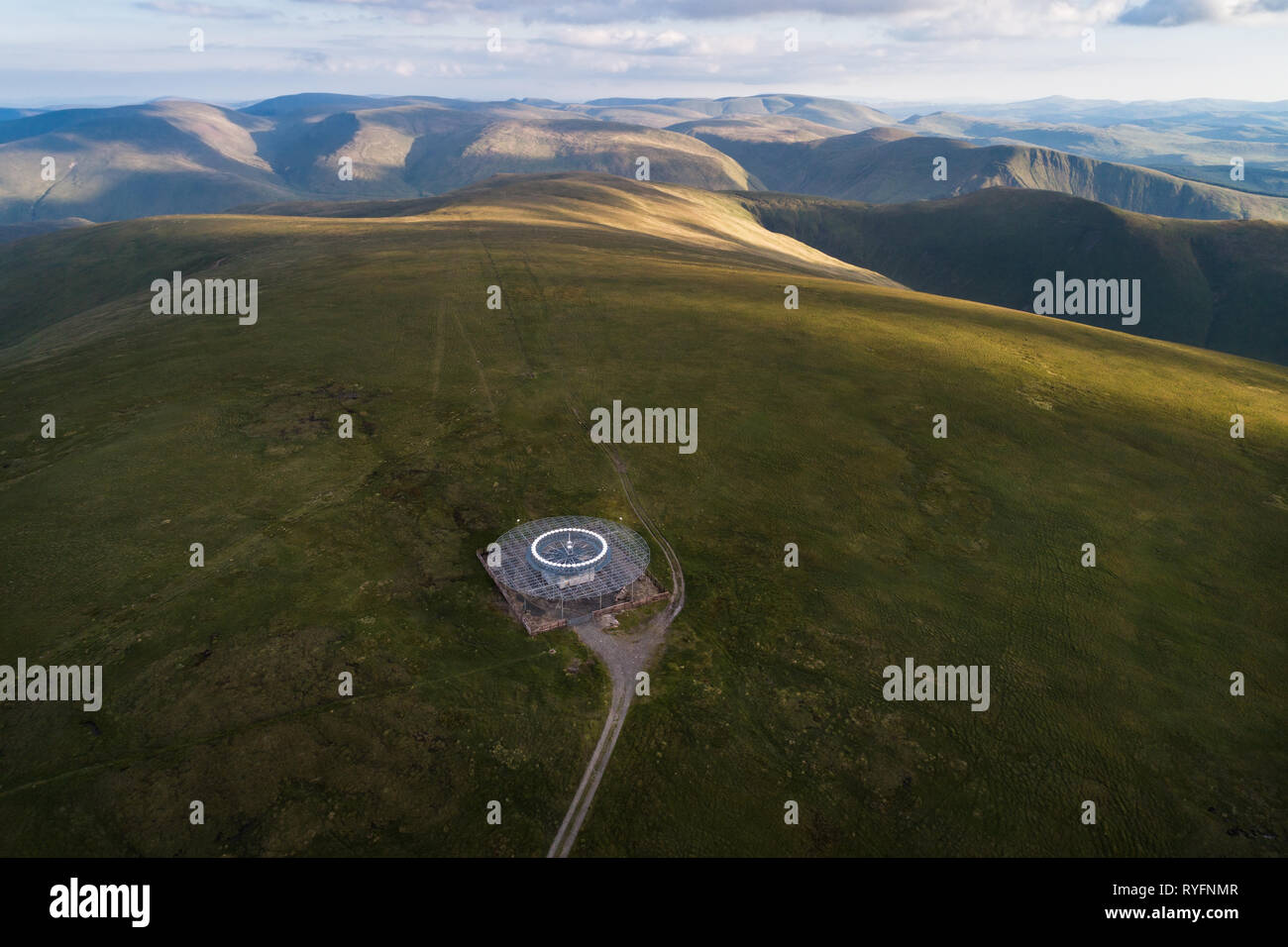 Aerial image showing the VOR/DME National Air Traffic Services beacon on the summit of Broad Law, the second highest point in Southern Scotland. - Stock Image