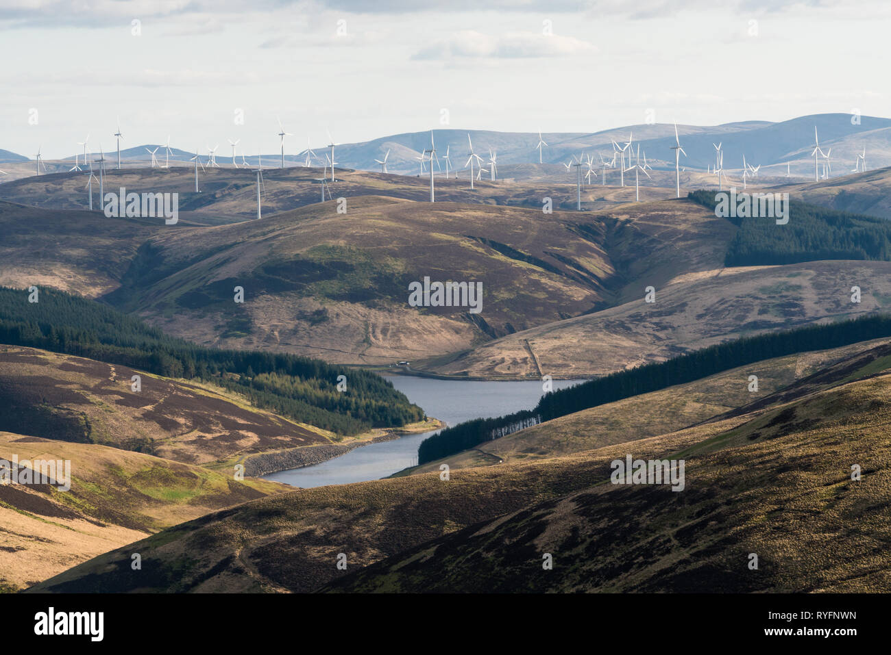 Camps Reservoir and the Clyde wind Farm seen from the high slopes of Hudderstone in the Southern Uplands. - Stock Image