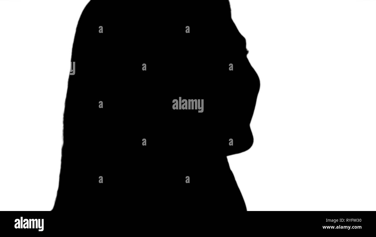 Silhouette Smiling blonde talking on the phone. - Stock Image