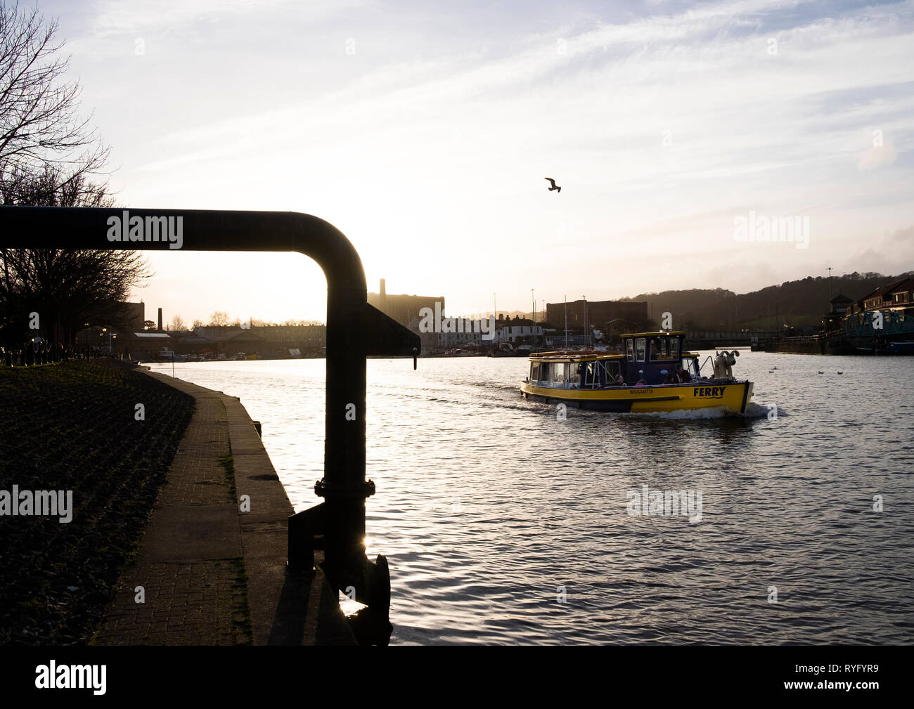 The final Bristol Harbour Ferry service of the day heading from the west of the harbour towards the city - Stock Image