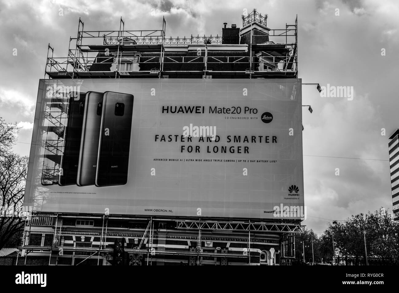 Scaffolds And Advertising For Huawei At Amsterdam The Netherlands 2018 In Black And White - Stock Image