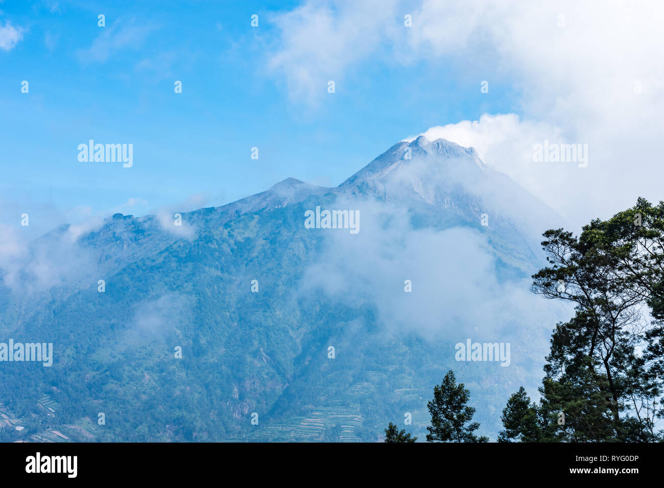 The very active peak of Mount Merapi volcano in Java Indonesia. - Stock Image