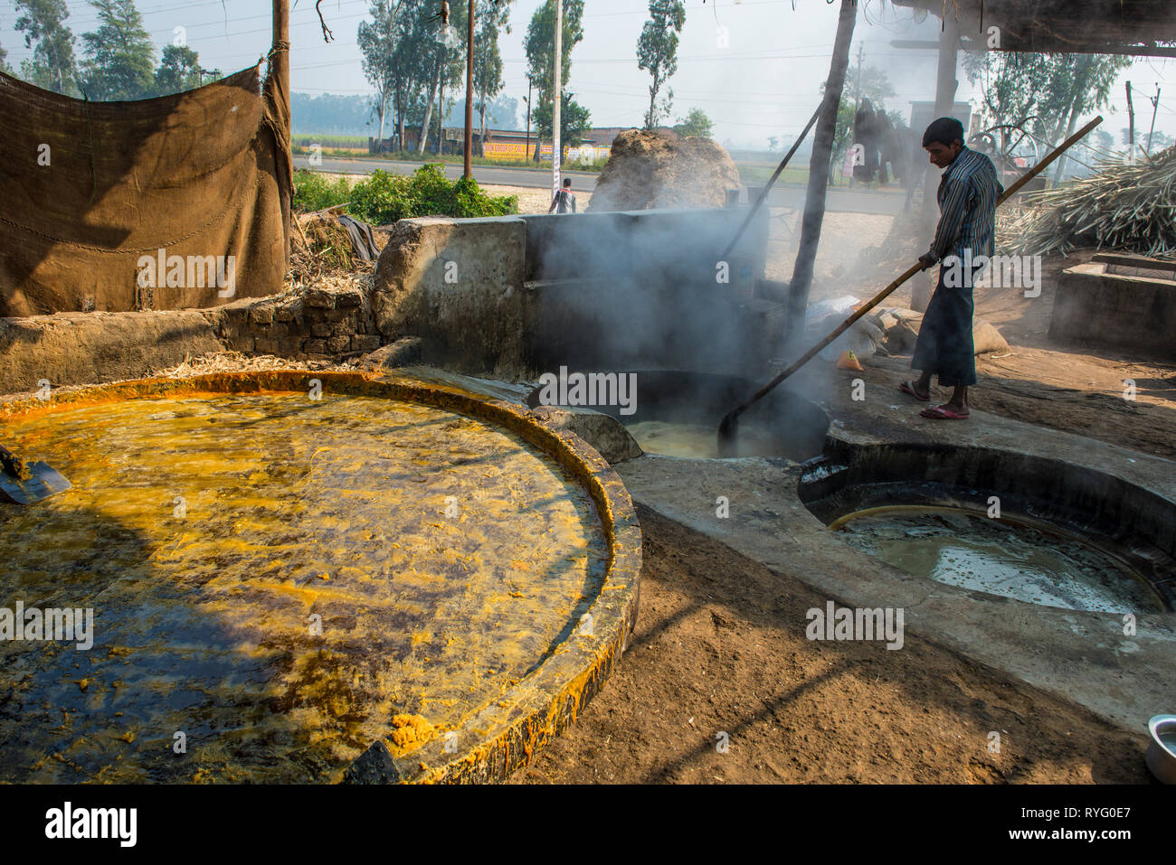 HIMACHAL PRADESH, INDIA. The juice of the sugar cane plant is transfomed to crystalline cane sugar by boiling Stock Photo