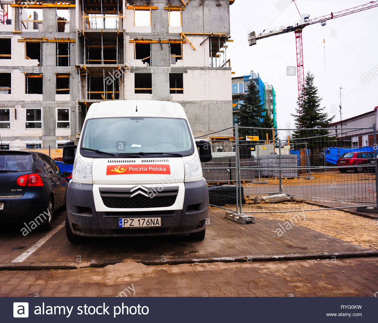 Poznan, Poland - March 3, 2019: Poczta Polksa Citroen delivery van parked on a parking spot in front of a apartment building under construction. Stock Photo