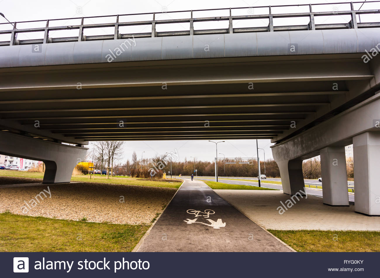 Poznan, Poland - March 3, 2019: Footpath and bike route under a bridge on the Inflancka street. Stock Photo