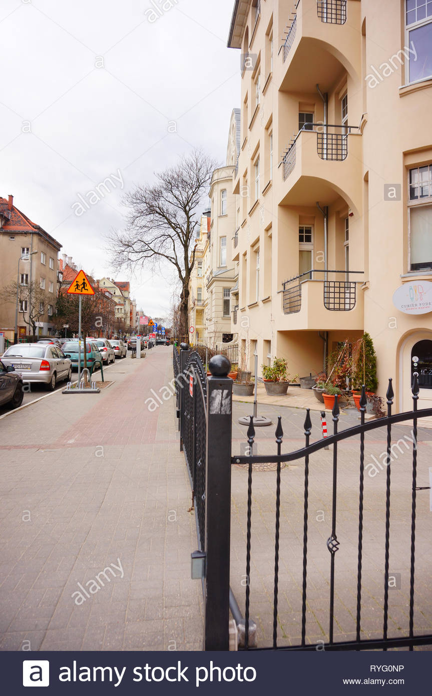Poznan, Poland - March 8, 2019: Metal fence in front of a apartment building on the Slowackiego street. Stock Photo