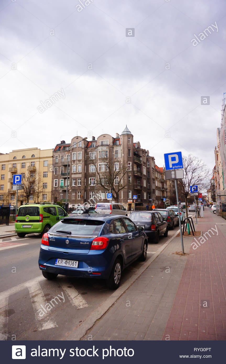 Poznan, Poland - March 8, 2019: Parked new blue Suzuki Baleno car on a non parking area on the Slowackiego street in the city center. Stock Photo