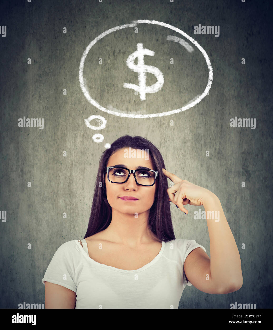 Woman dreaming of financial success thinking how to start a profitable business - Stock Image