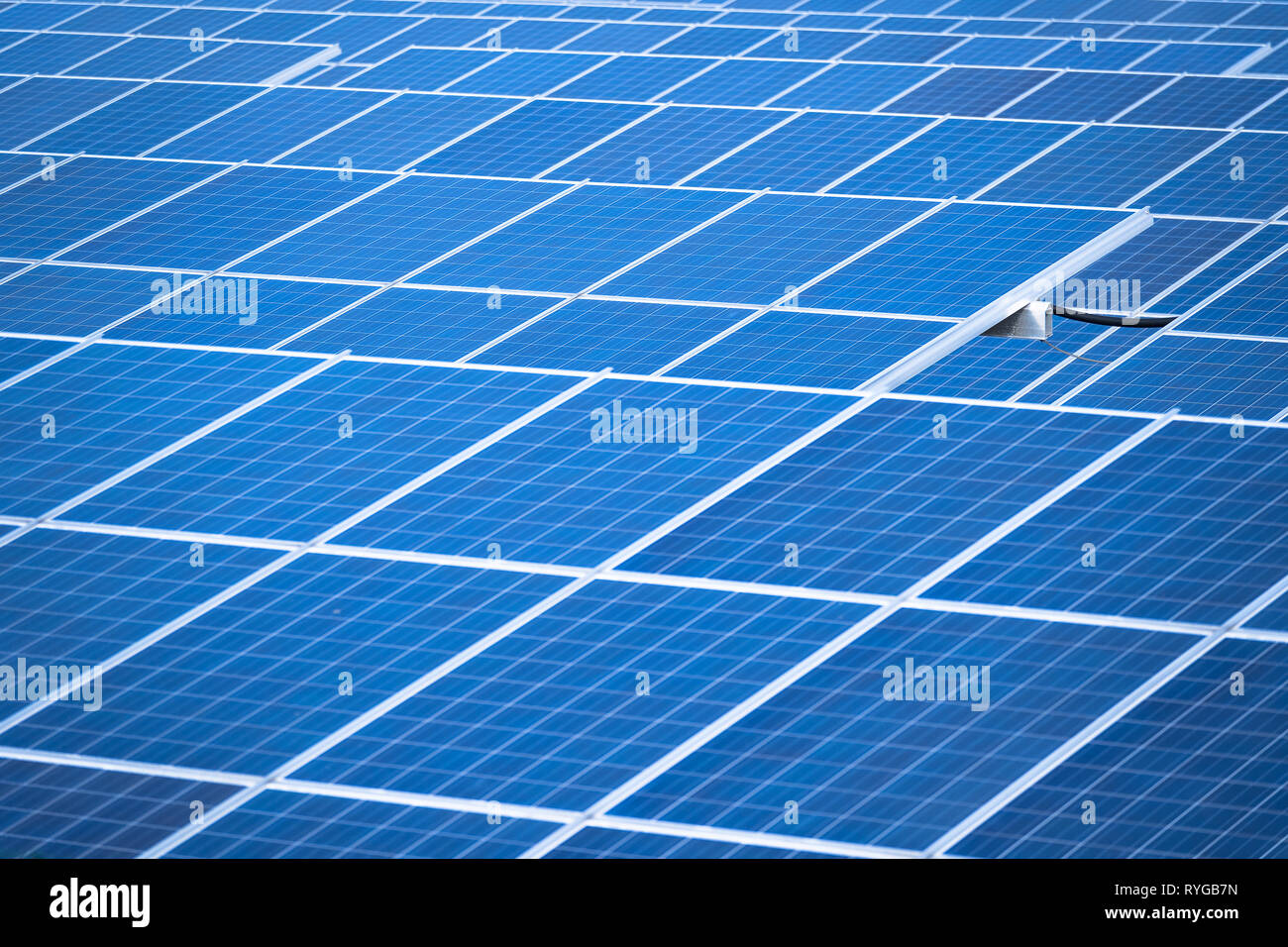 Solar panels in a row, solar panels grid, close up. photovoltaic system - Stock Image