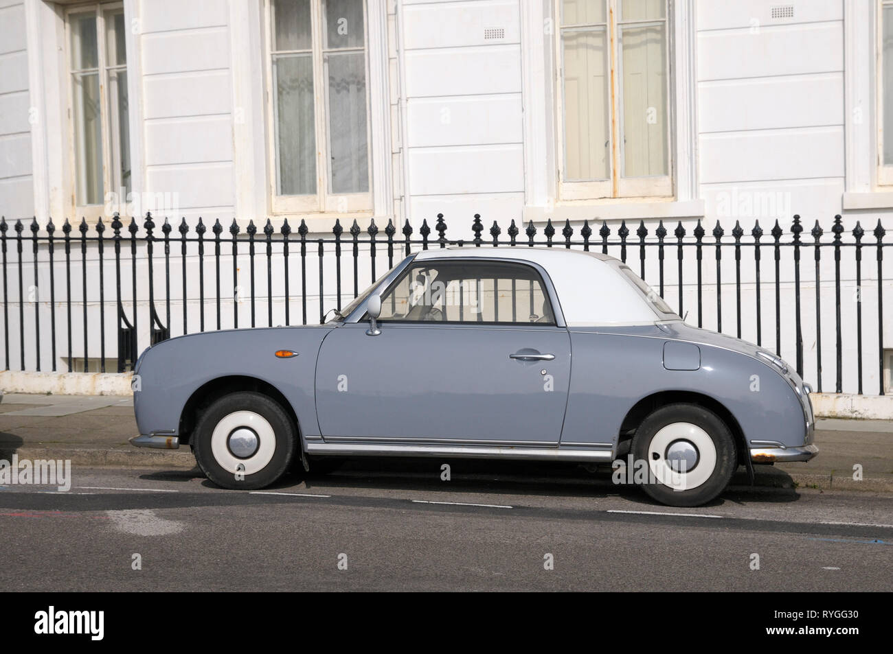 A retro-styled Lapis Grey Nissan Figaro car parked in Brighton, East Sussex, England, UK - Stock Image