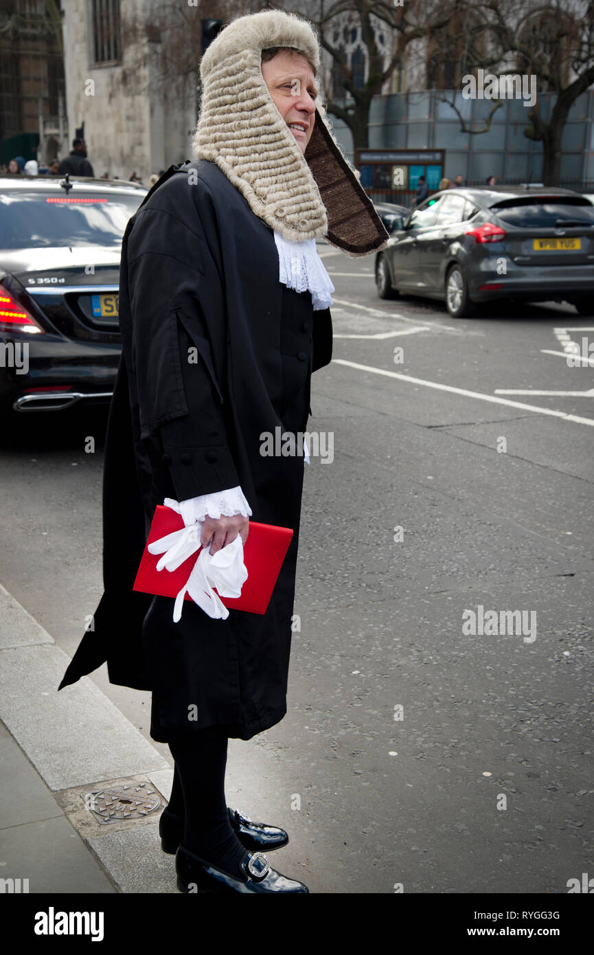 Monday March 11th 2019. Parliament Square. A newly appointed Queen's Counsel waits for a taxi. - Stock Image