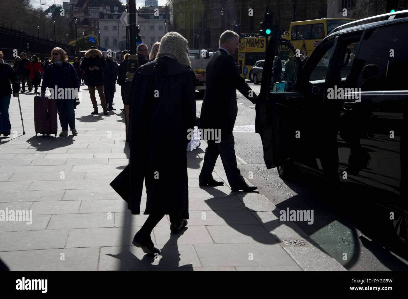 Monday March 11th 2019. Parliament Square. A newly appointed Queens Counsel about to get into a taxi - Stock Image