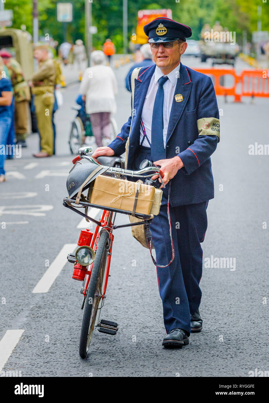 Woodhall Spa 1940s Festival - a 1940s postman with bicycle Stock Photo