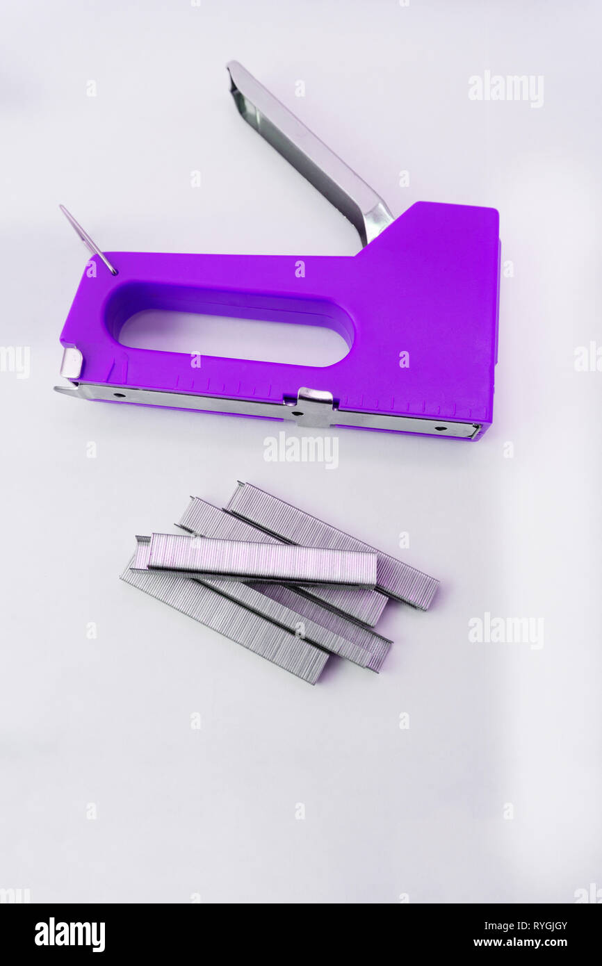 furniture stapler chrome craft device fasteners firm fix - Stock Image