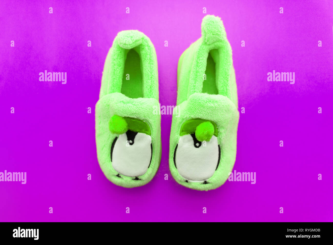 Pair of green textile slippers isolated over white - Stock Image