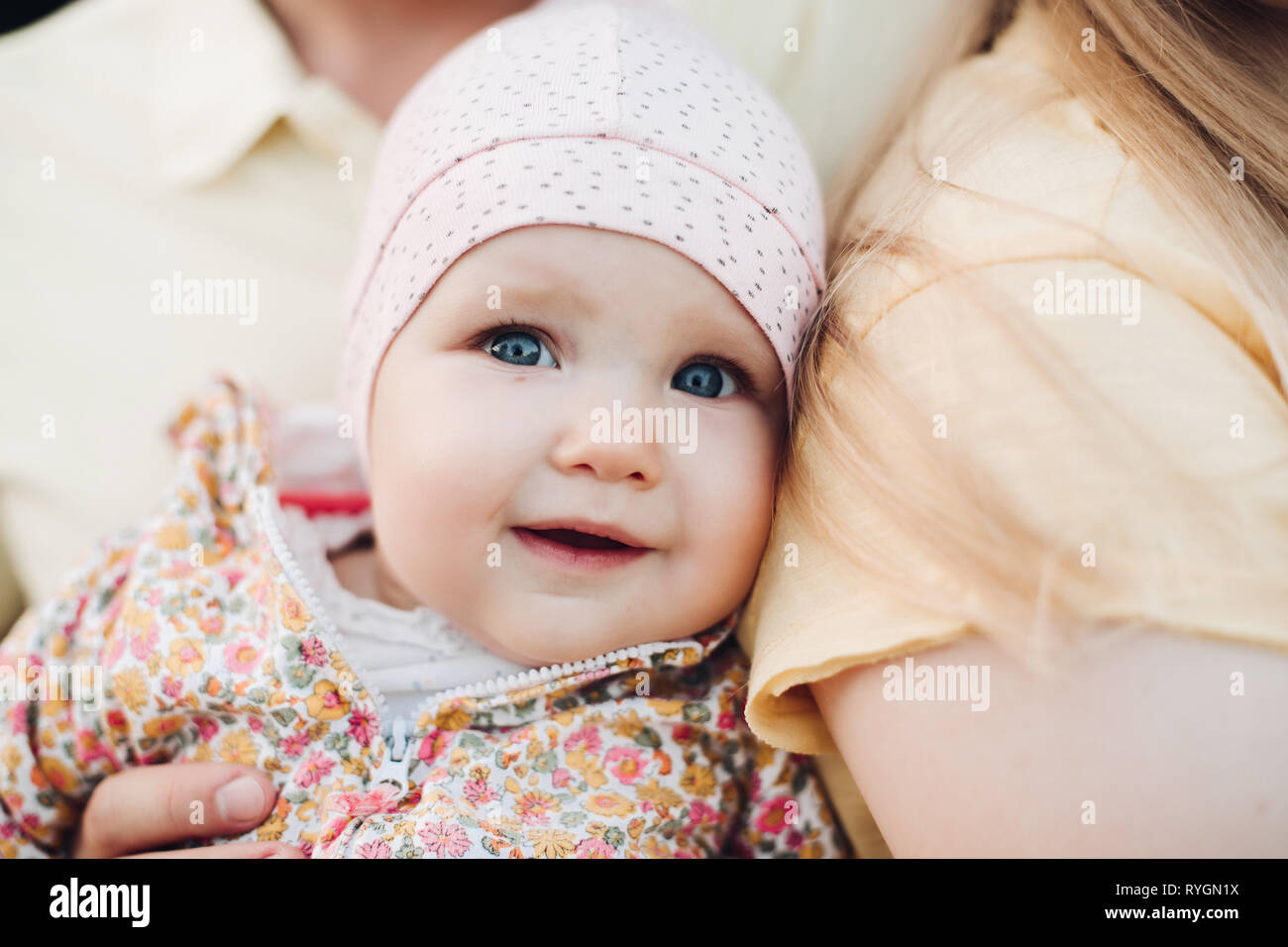 Close up of surprised baby's face with lightly opened mouth. Stock Photo