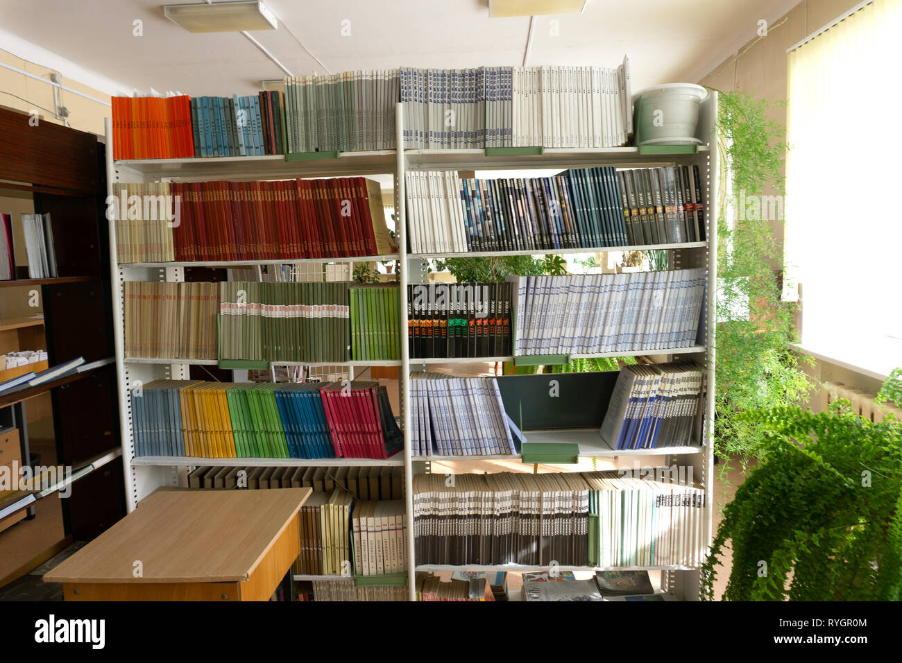 Old books in the library are on the shelves . Russia Berezniki on March 23, 2018 . - Stock Image