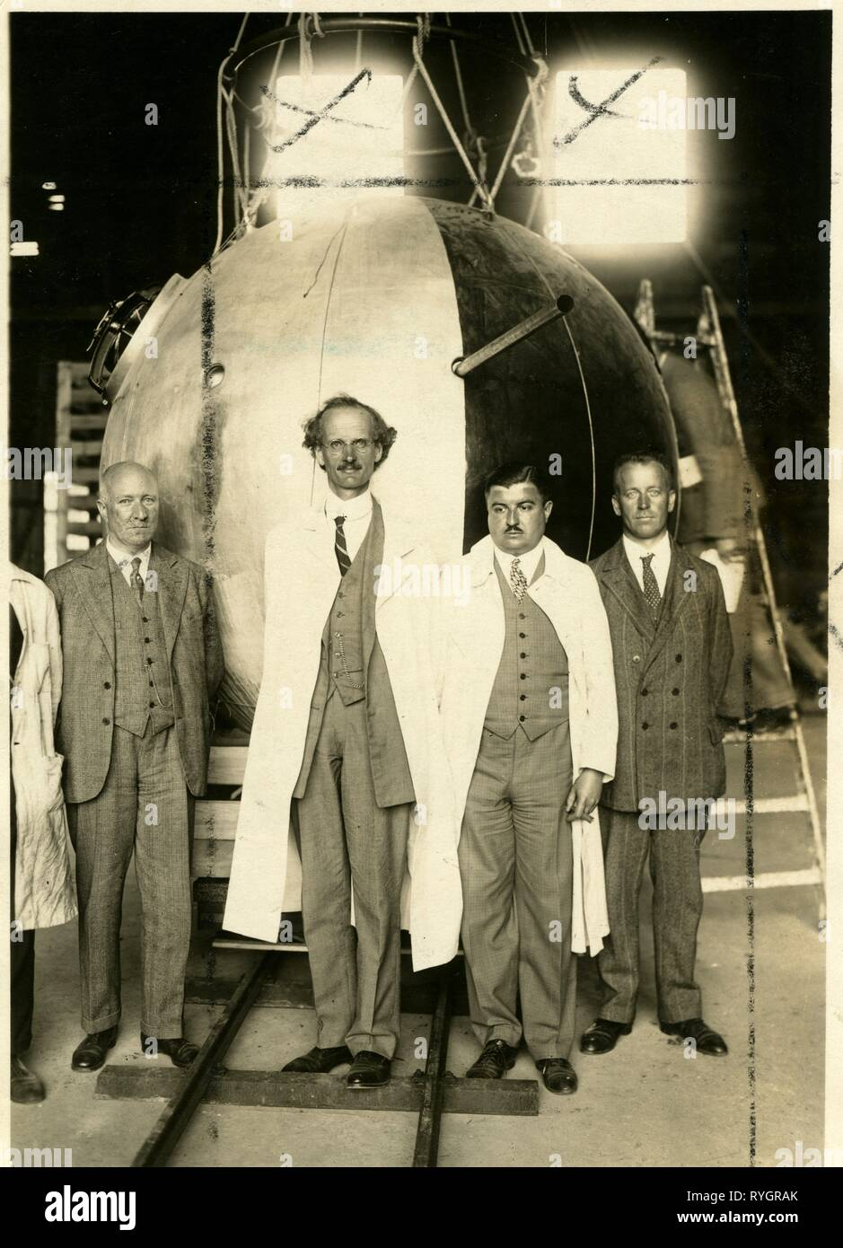 On the 27th May 1931, Professor Piccard, a Swiss physicist, took off for the stratosphere in a pressurised aluminium capsule, attached to a large hydrogen balloon. Piccard and his assistant, Paul Kipfer, reached a record height of 9.8 miles or 15,785 metres. They were launched in Augsberg, Germany and were hoping to touch down in the Adriatic, eventually crashing on a glacier in the Austrian Alps. They made a second ascent the next year reaching 10 miles, then went on in further ascents to the giddy height of 14 miles or 23,000 metres.  Piccard was the inspiration for Calculus in Tintin. - Stock Image