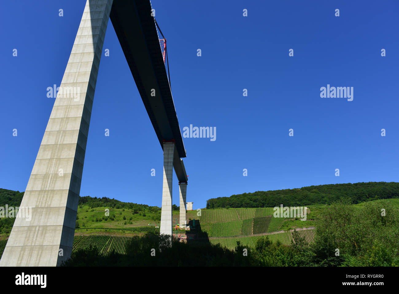 Construction of the bridge over the Mosel river, with grapeyards at background - Stock Image