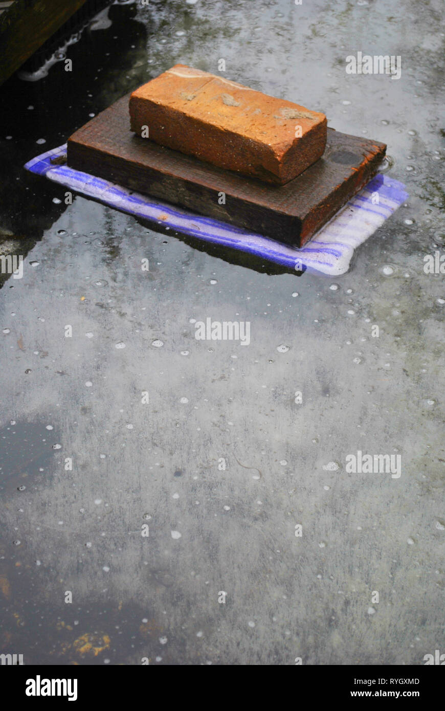 Frozen stone on ice and cold wintertime - Stock Image