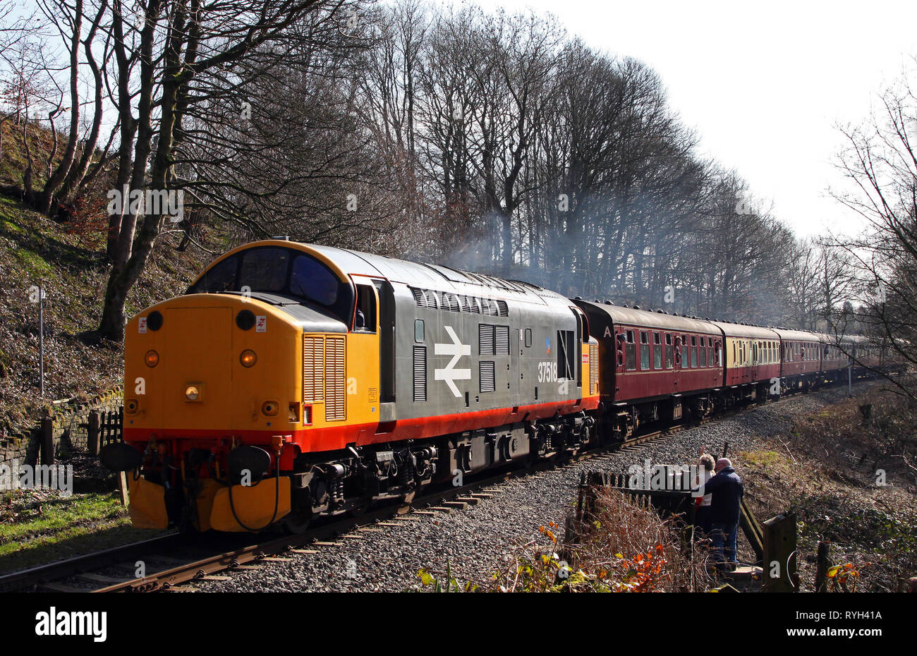 37518 heads past Summerseat on the East Lancs Railway. - Stock Image