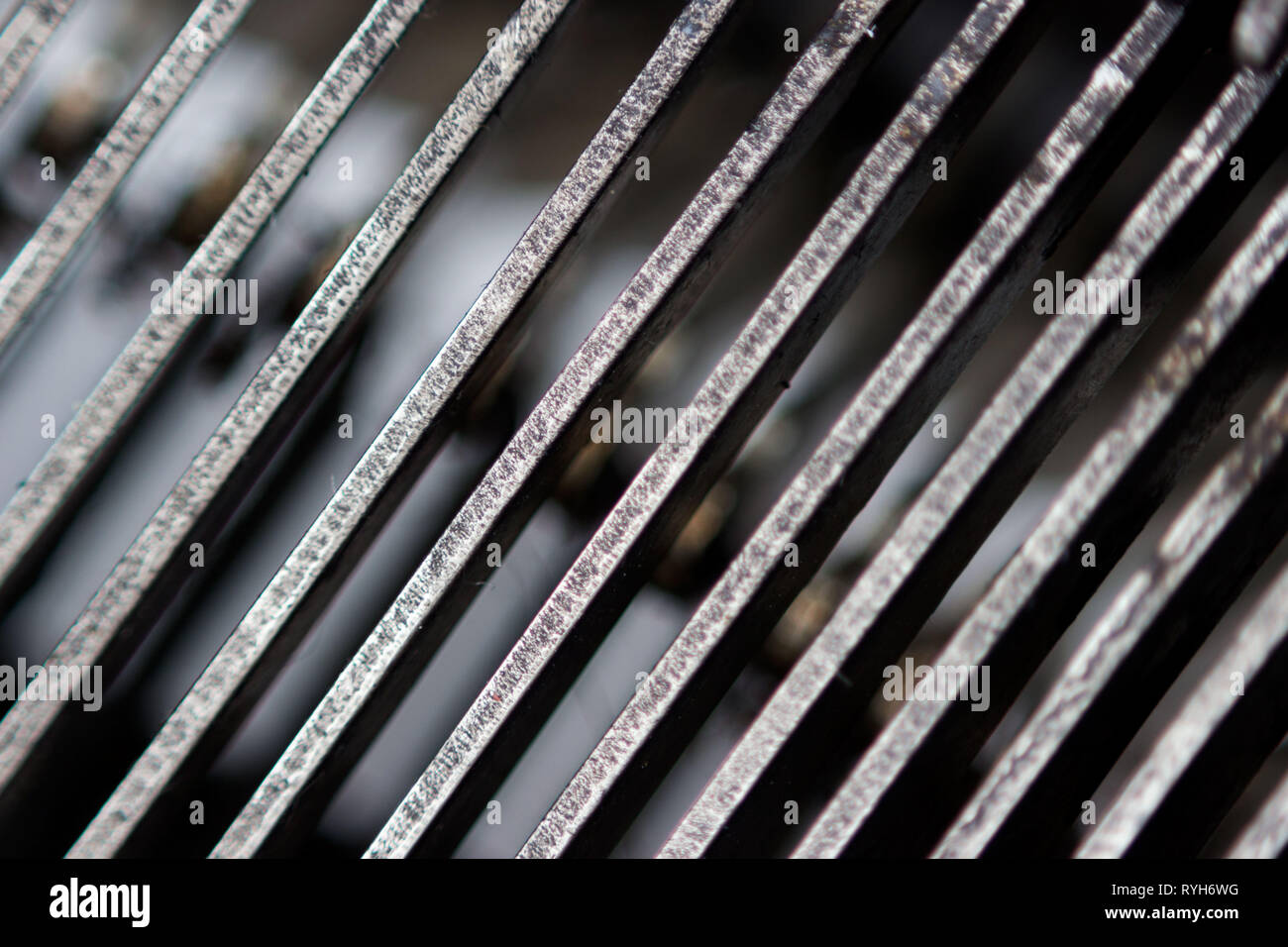 Hammers with letters, numbers and punctuation. Internal structure of the old Soviet typewriter close-up. Stock Photo
