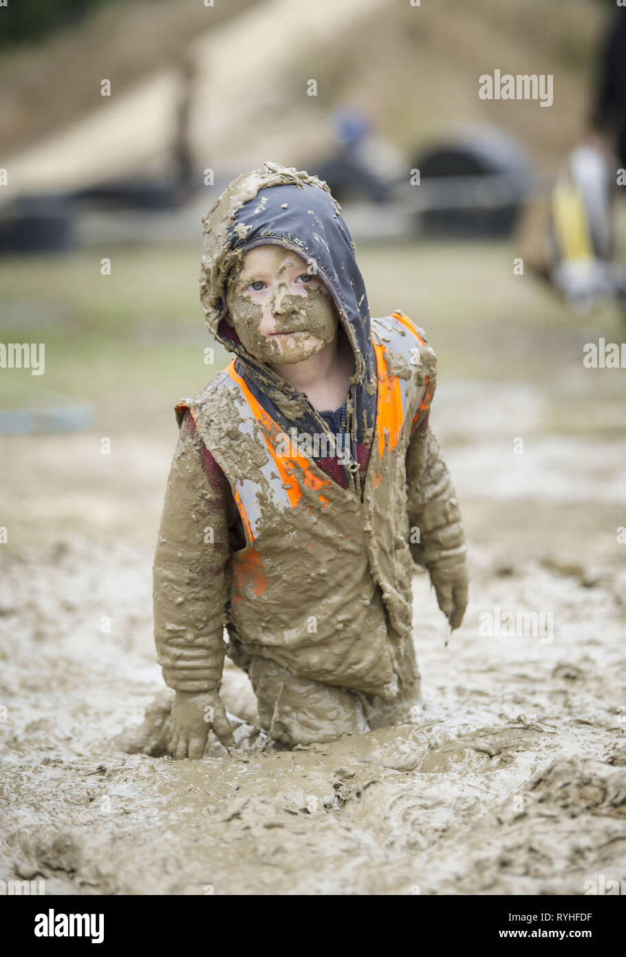 Christchurch, Canterbury, New Zealand. 14th Mar, 2019. Parents and children romp in ''messy mud nature play'' at Bottle Lake Forest Park, part of the city's Parks Week. Credit: PJ Heller/ZUMA Wire/Alamy Live News - Stock Image