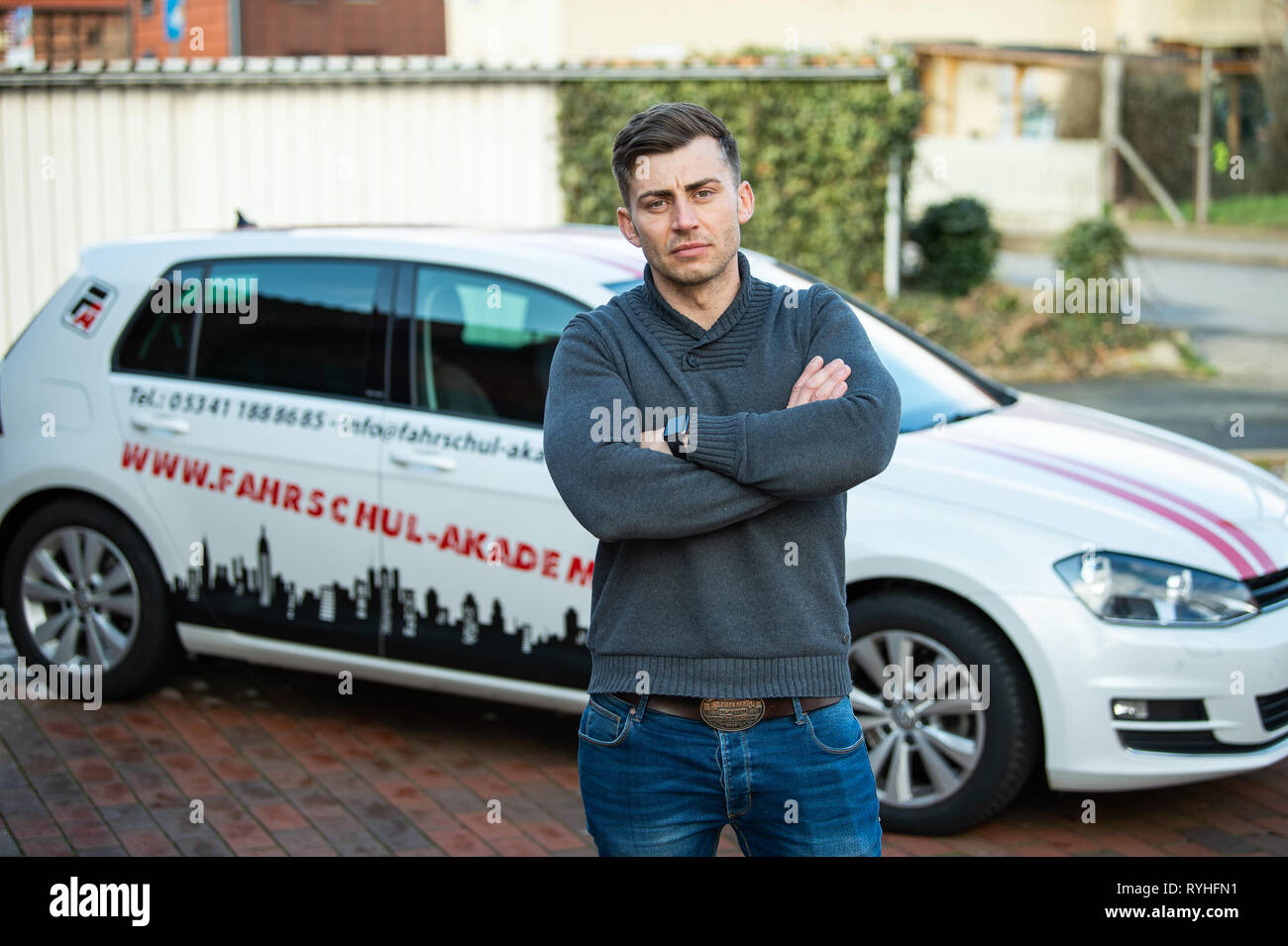 Lengede, Germany. 05th Mar, 2019. Tom Gerhard Tiessen, head of the A and G Driving Academy, stands in front of a driving school car. The European Court of Justice (ECJ) will decide on 14.03.2019 whether driving schools will be exempted from VAT. Tiessen had initiated the proceedings. Credit: Christophe Gateau/dpa/Alamy Live News - Stock Image