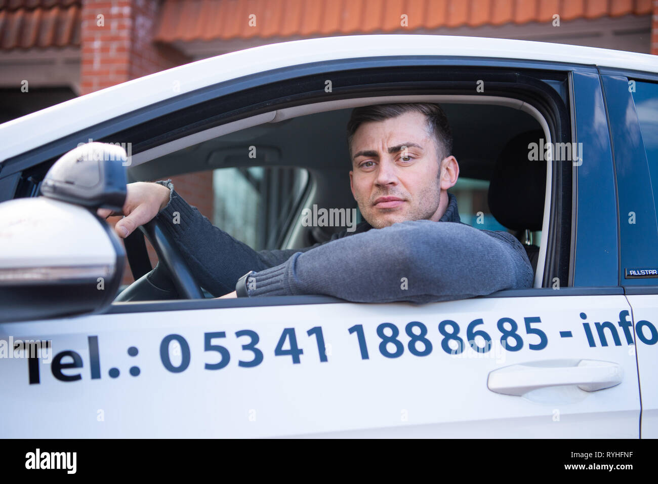 Lengede, Germany. 05th Mar, 2019. Tom Gerhard Tiessen, head of the A and G Driving Academy, sits in a driving school car. The European Court of Justice (ECJ) will decide on 14.03.2019 whether driving schools will be exempted from VAT. Tiessen had initiated the proceedings. Credit: Christophe Gateau/dpa/Alamy Live News - Stock Image