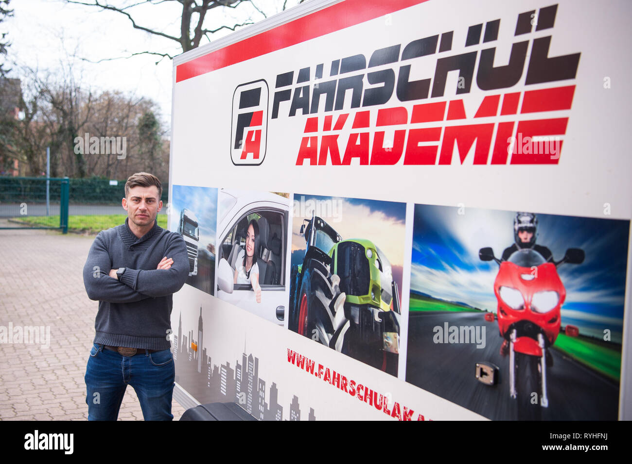 Lengede, Germany. 05th Mar, 2019. Tom Gerhard Tiessen, head of the A and G Driving Academy, stands next to a trailer with the logo of his driving school. The European Court of Justice (ECJ) will decide on 14.03.2019 whether driving schools will be exempted from VAT. Tiessen had initiated the proceedings. Credit: Christophe Gateau/dpa/Alamy Live News Stock Photo