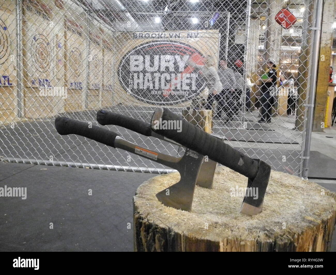 New York, USA. 15th Jan, 2019. Axes are stuck in a tree stump in a branch of the company Bury the Hatchet in New York's Brooklyn district, where guests can book a train to throw these hand axes at wooden targets. (to dpa - News from the scene - Instead of darts or bowling: Axe throwing becomes in the USA pub sport) Credit: Johannes Schmitt-Tegge/dpa/Alamy Live News Stock Photo