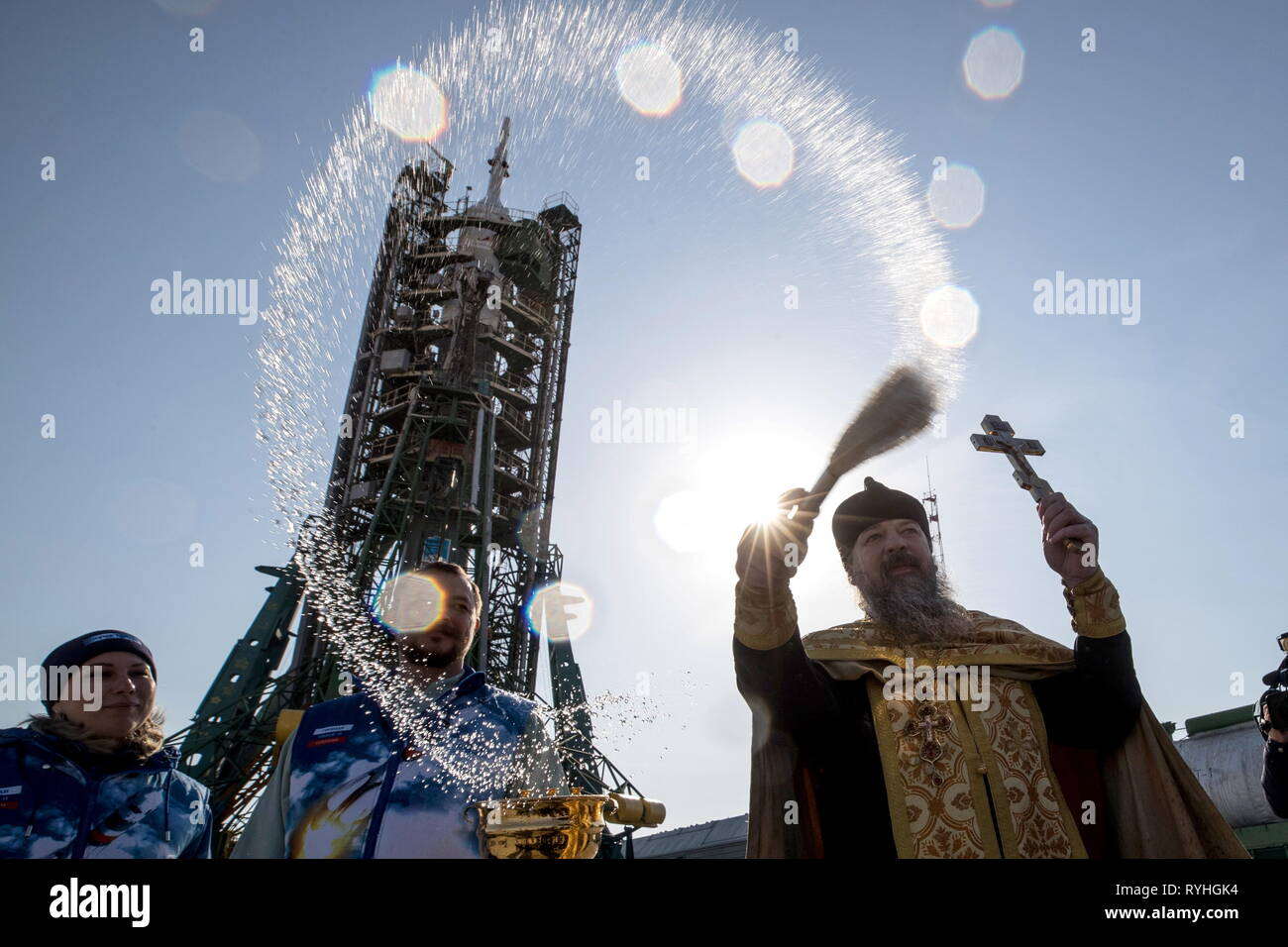Kazakhstan. 14th Mar, 2019. KAZAKHSTAN - MARCH 14, 2019: An Orthodox priest blesses a Soyuz-FG rocket booster carrying the Soyuz MS-12 and installed on a launch pad at the Baikonur Cosmodrome. The launch of the Soyuz MS-12 spacecraft crew of Roscosmos cosmonaut Alexei Ovchinin and NASA astronauts Nick Hague, Christina Koch to the International Space Station (ISS) is scheduled for March 14, 2019. Sergei Savostyanov/TASS Credit: ITAR-TASS News Agency/Alamy Live News Stock Photo