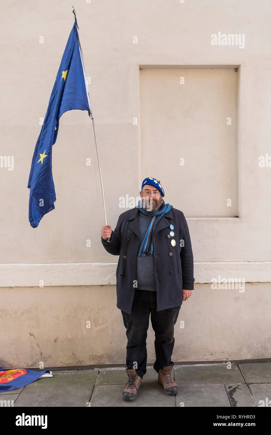 London, UK. 14th Mar, 2019. A pro-remain supporter poses with his Europe flag in Westminster. MPs are due to vote on whether to delay the departure date for Brexit later today. Credit: Stephen Chung/Alamy Live News Stock Photo