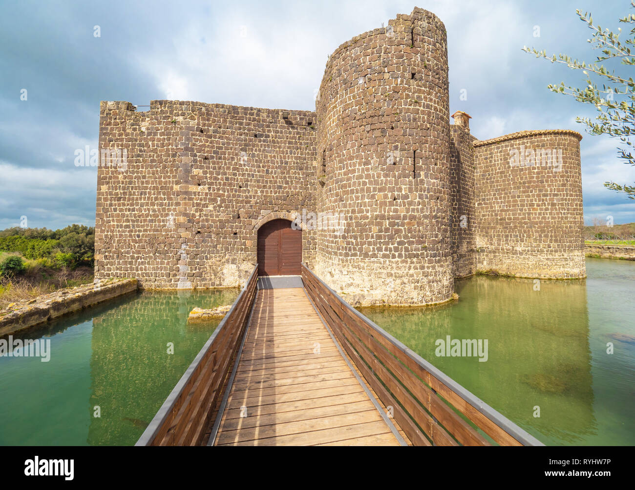 Vulci (Italy) - The medieval castle of Vulci, now museum, with Devil's bridge. Vulci is an etruscan ruins city in Lazio region, on the Fiora river Stock Photo