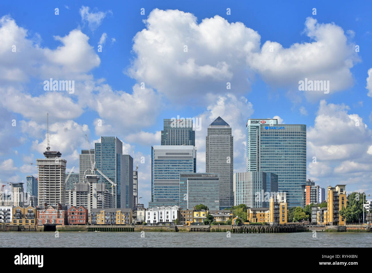 Building site construction cranes continue to expand Canary Wharf London Docklands cityscape skyline on the Isle of Dogs Newham East London England UK - Stock Image