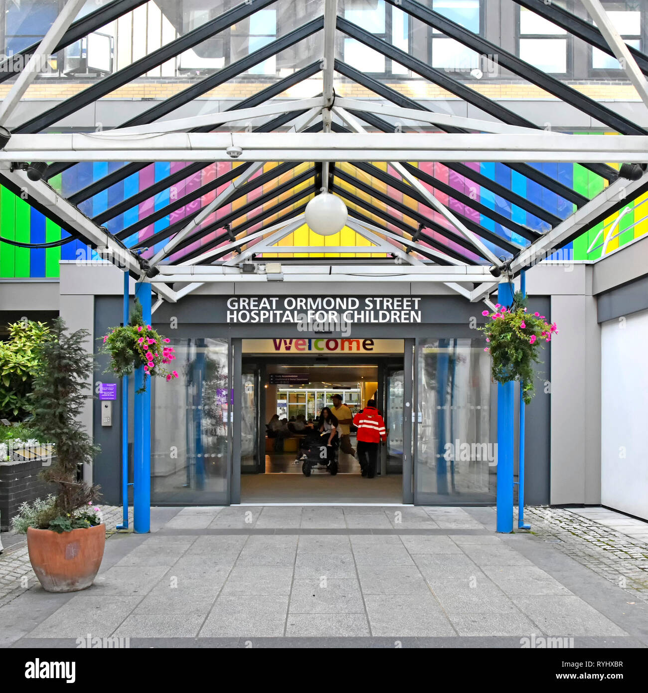Welcome sign & colourful entrance at Great Ormond Street Hospital a NHS healthcare centre for sick children in Bloomsbury Camden London England UK - Stock Image