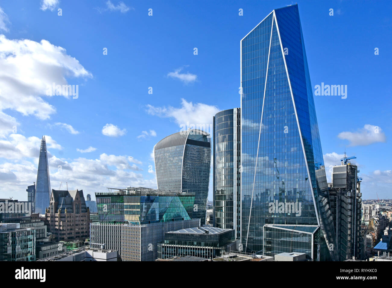 Glass reflective cladding on the new modern Scalpel landmark skyscraper office building in City of London skyline with views to the Shard England UK - Stock Image