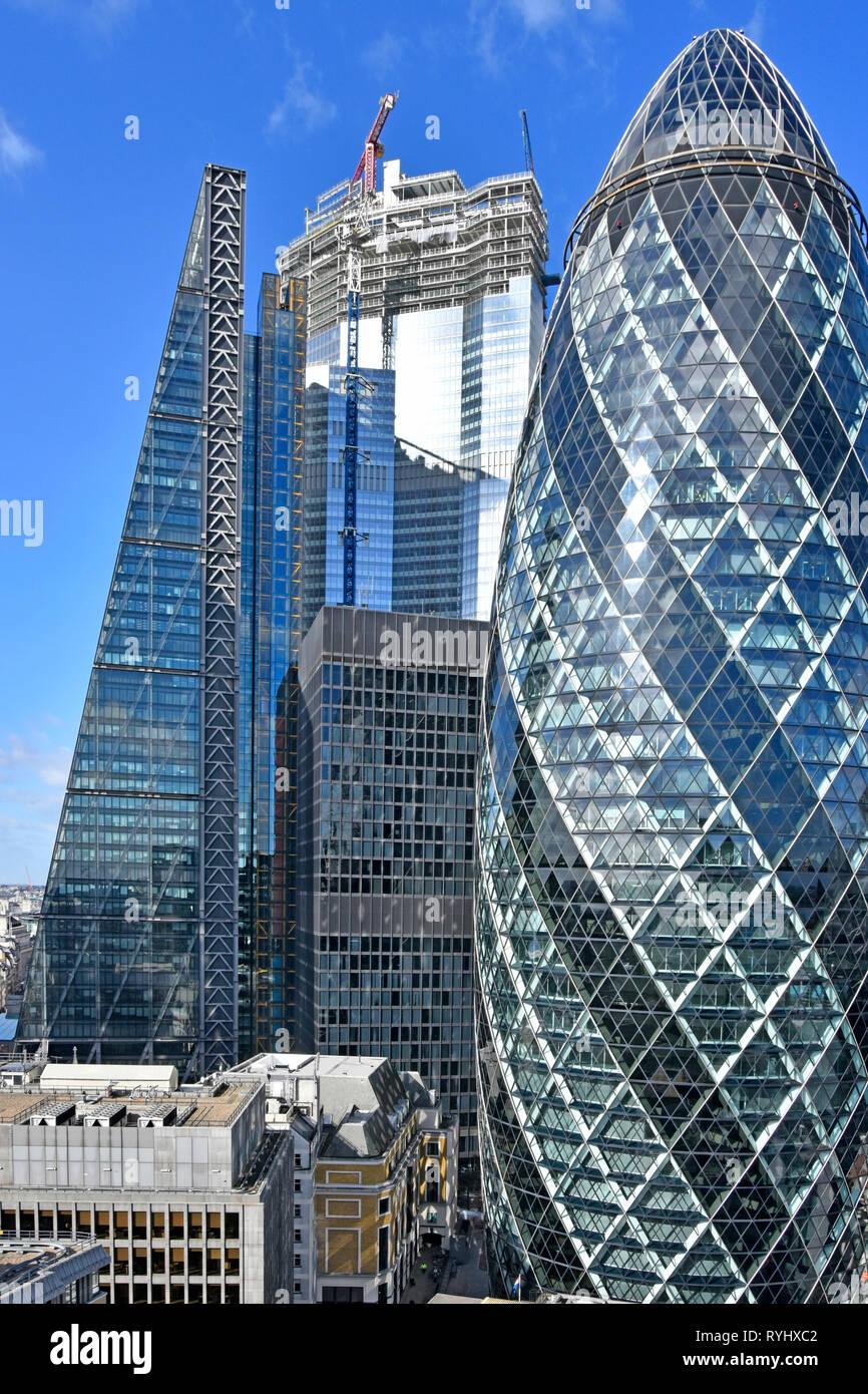 City of London skyline cityscape the Pinnacle skyscraper building under construction  between nearby landmarks Leadenhall Building & Gherkin London UK - Stock Image