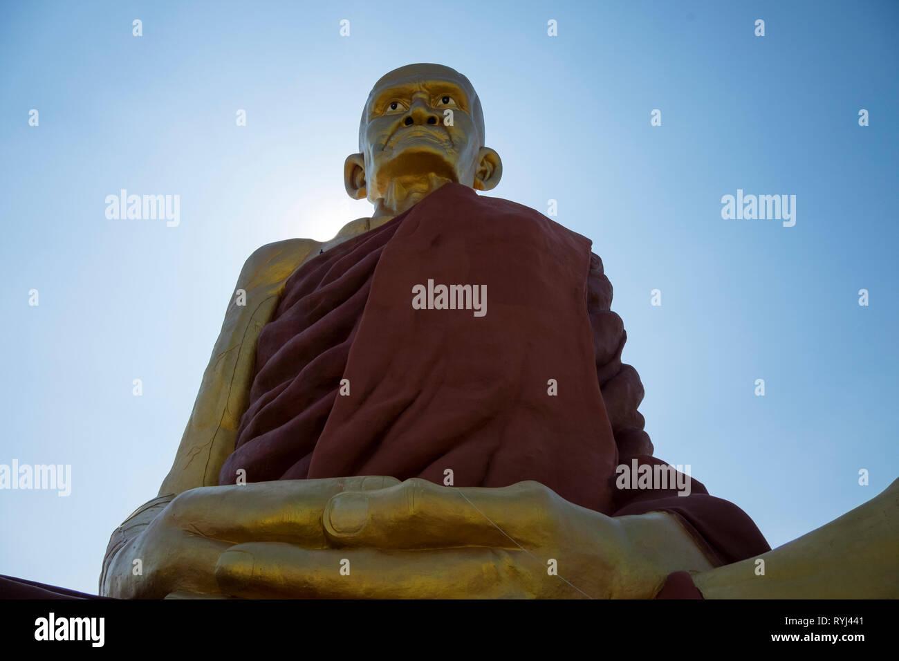 Mun Bhuridatta, a revered monk, looms over the landscape in Khon Kaen, Thailand. - Stock Image