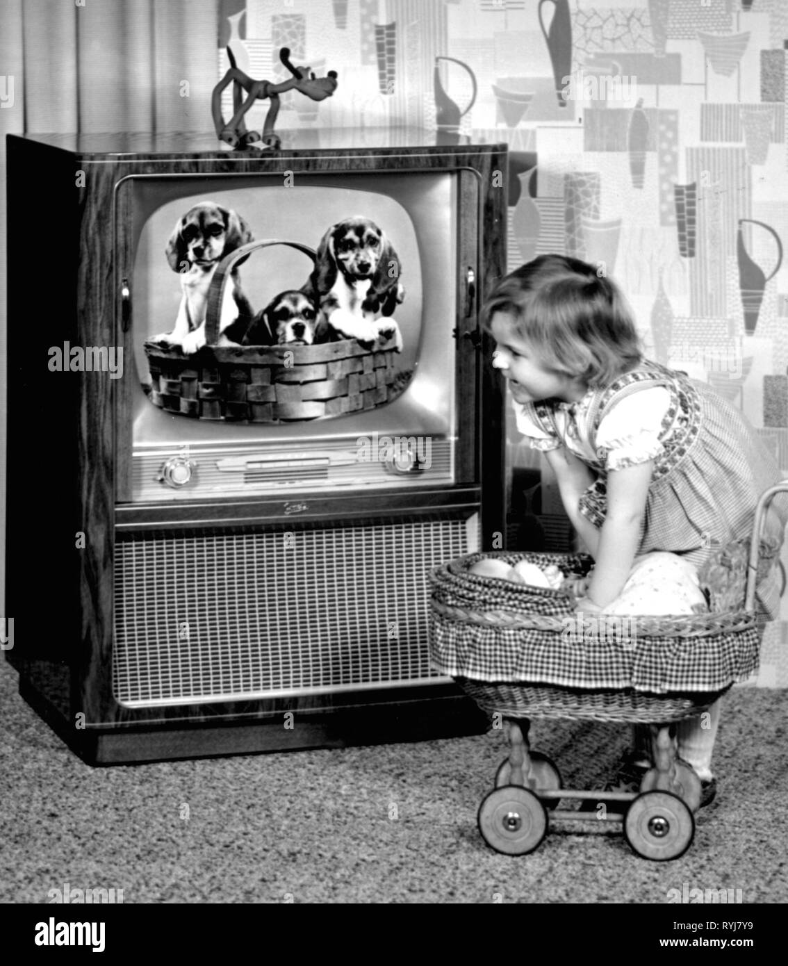 broadcast, television, little girl with a pram in front of a