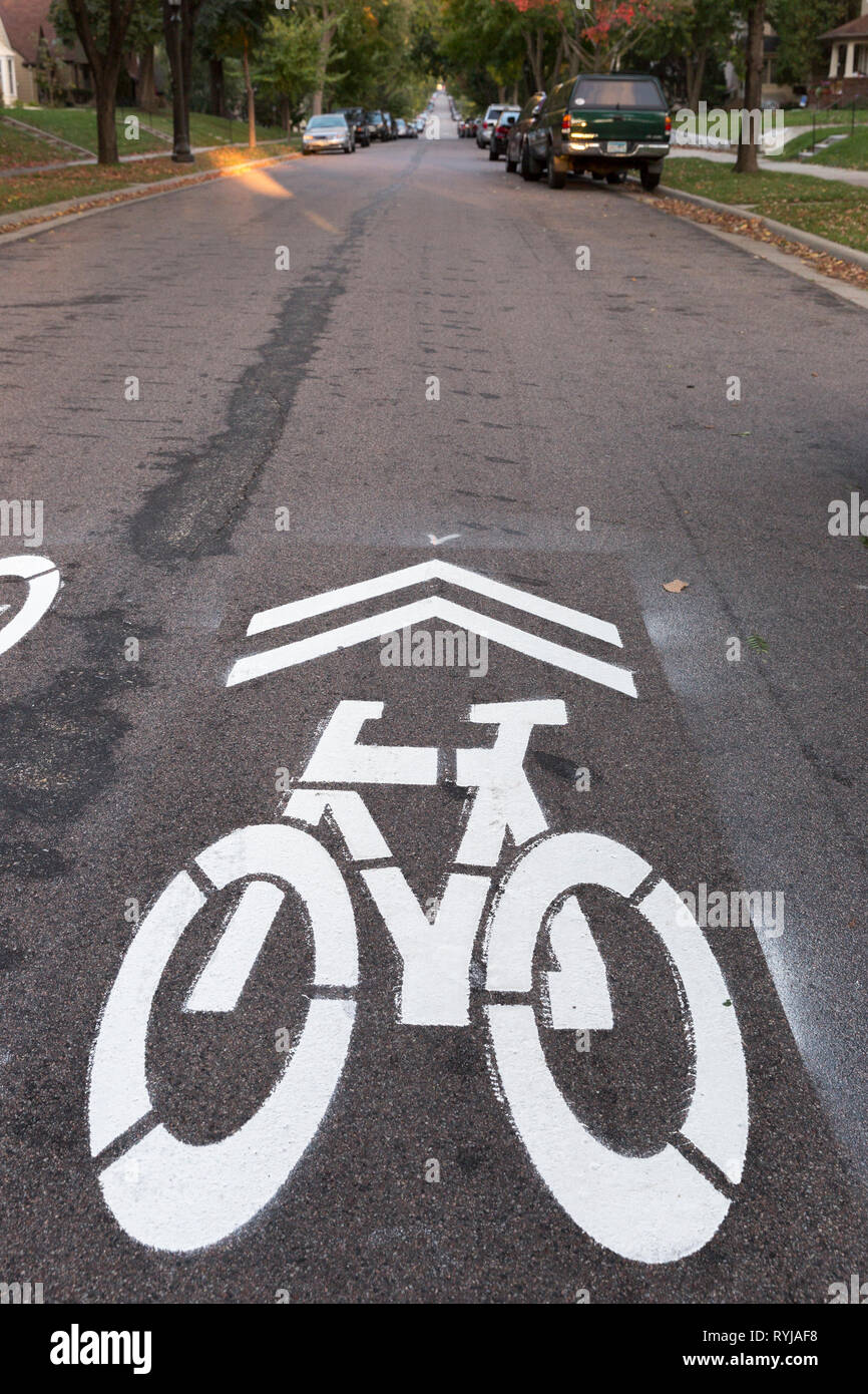 A shared-lane marking or sharrow marking for a bicycle route on Jefferson Avenue in St. Paul, Minnesota.  In the US, the wide shape of the arrow combi - Stock Image