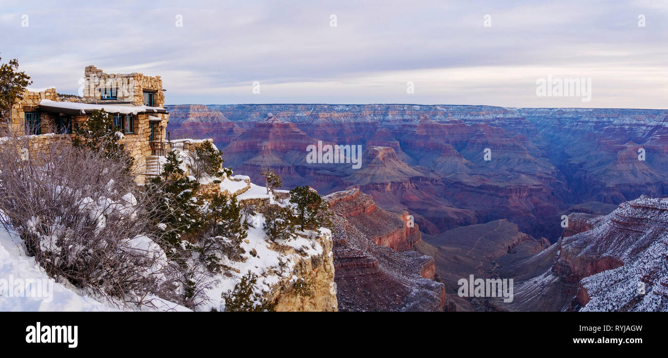 Lookout Studio and the Grand Canyon morning panorama. Bright Angel Canyon, which runs along a fault line, is at right. - Stock Image